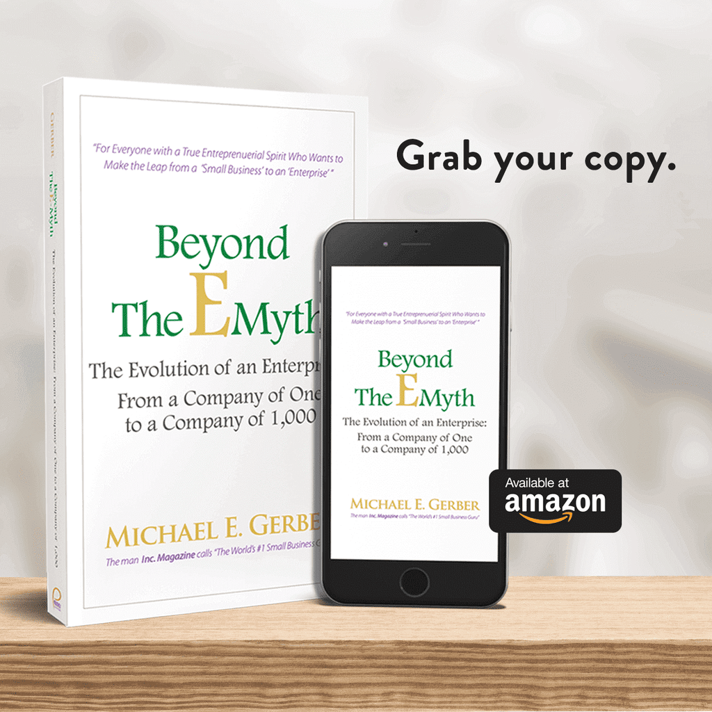 """Image of Michael E Gerber's book """"Beyond The EMyth"""", beside a tablet."""