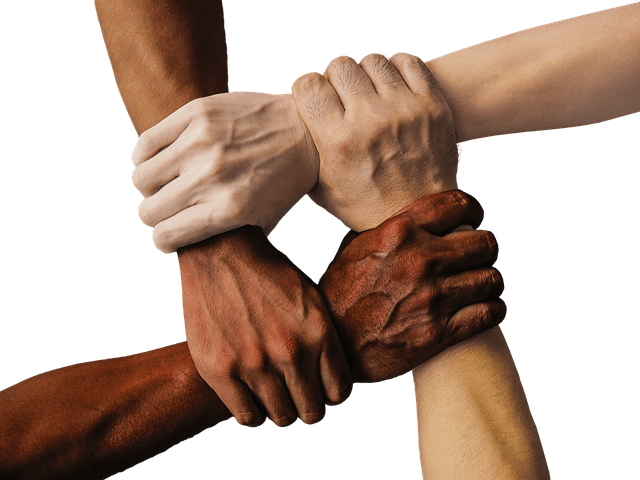Image of diverse people in business linking wrists