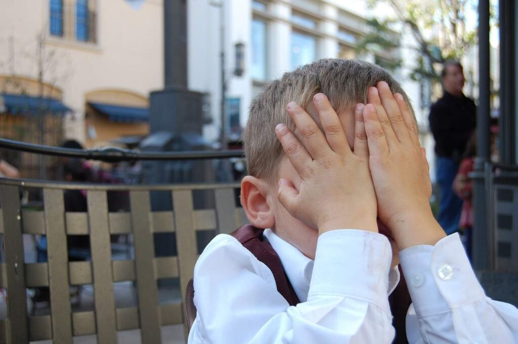 Image of boy hiding face from four common mistakes.