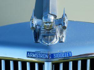 Image of bonnet badge of an Armstong Siddeley vintage motor car.